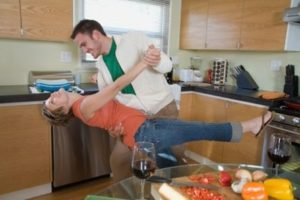 couple having fun in kitchen